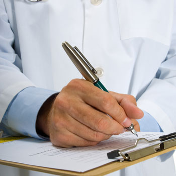General Practitioner writing referral